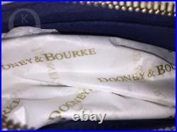 NWOTDooney & BourkeDisney ParksDisneyLand 60th Anniversary Lg Slim Wristlet